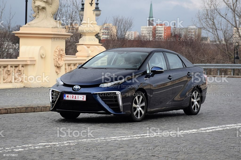 Fuel cell vehicle driving on the street stock photo