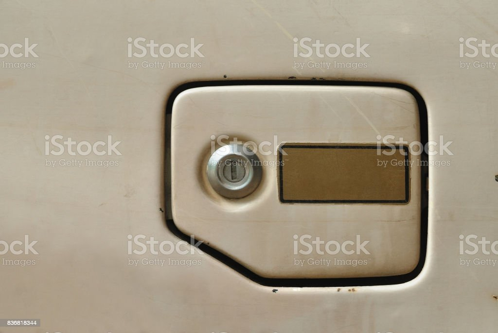 Fuel filler cover of old car . stock photo