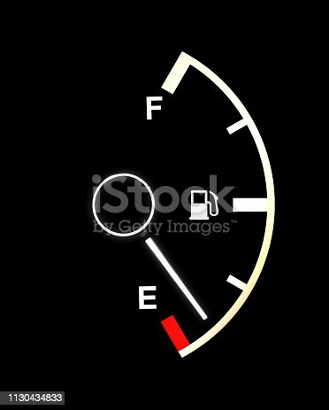 Fuel gauge showing almost an empty tank on black background