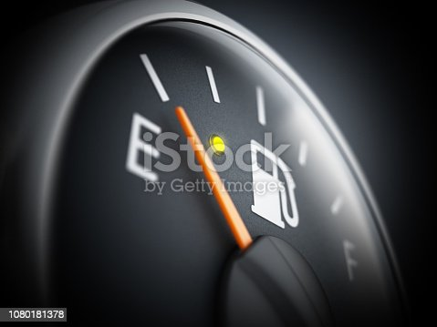 Fuel gauge with needle on E indicating empty car tank
