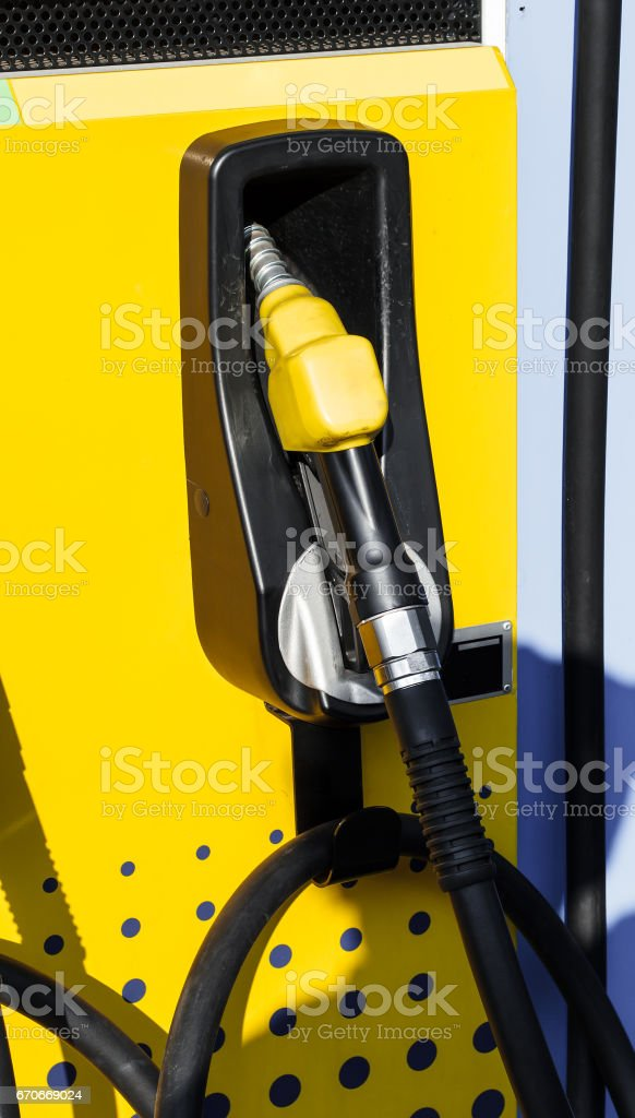 Fuel Nozzle in Gas Station stock photo