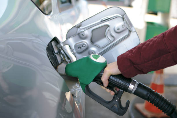 Fuel pump at petrol station Female hand refilling the car with fuel at petrol station. biodiesel stock pictures, royalty-free photos & images
