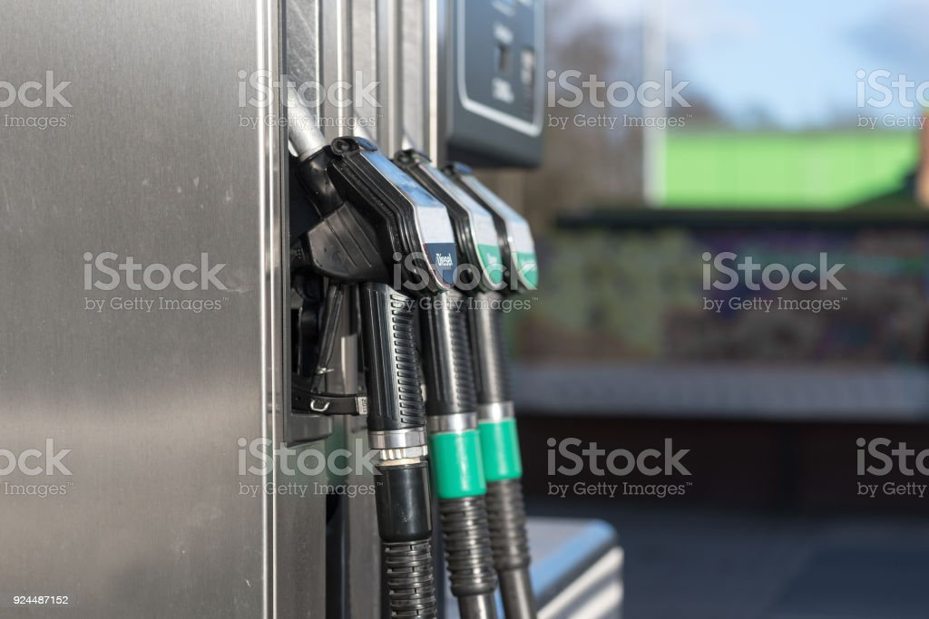 fuel pump filling nozzles for petrol and diesel at a gasoline station, copy space stock photo