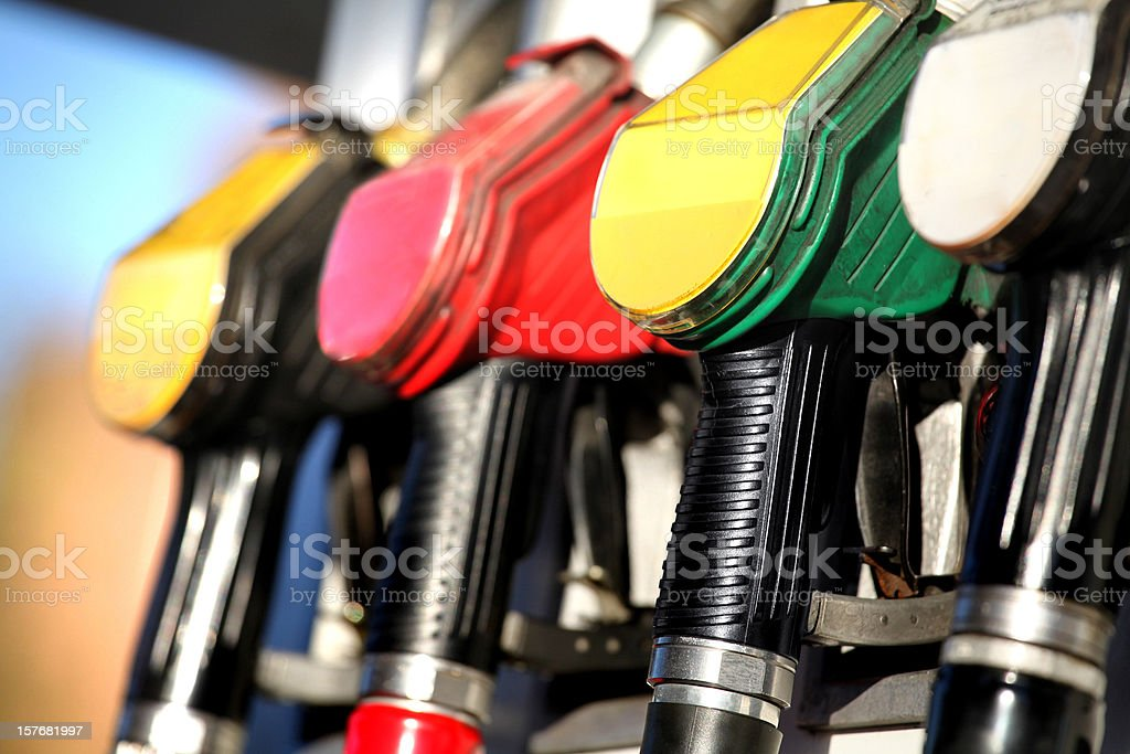 Fuel pump nozzles close up in a service station royalty-free stock photo
