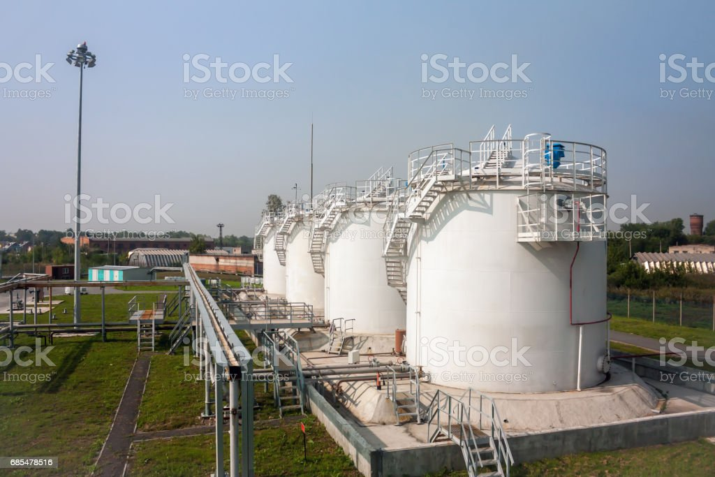 Fuel store tanks of refueling complex in the airport стоковое фото