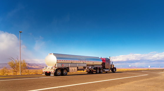 Fuel tanker driving on a single lane road USA