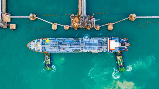 Fuel tanker ship loading in port view from above, Tanker ship logistic import export business and transportation, Aerial view. stock photo
