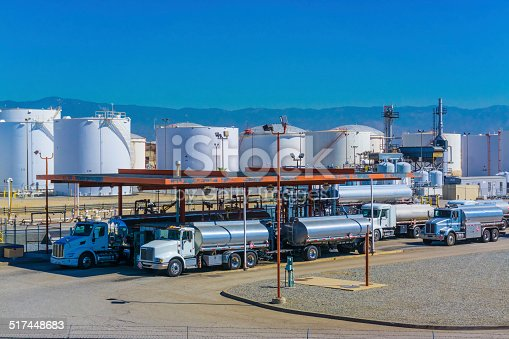 Fuel tanker trucks at refinery fueling station, CA