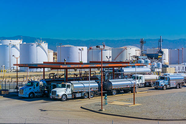 fuel tanker trucks - station stock pictures, royalty-free photos & images