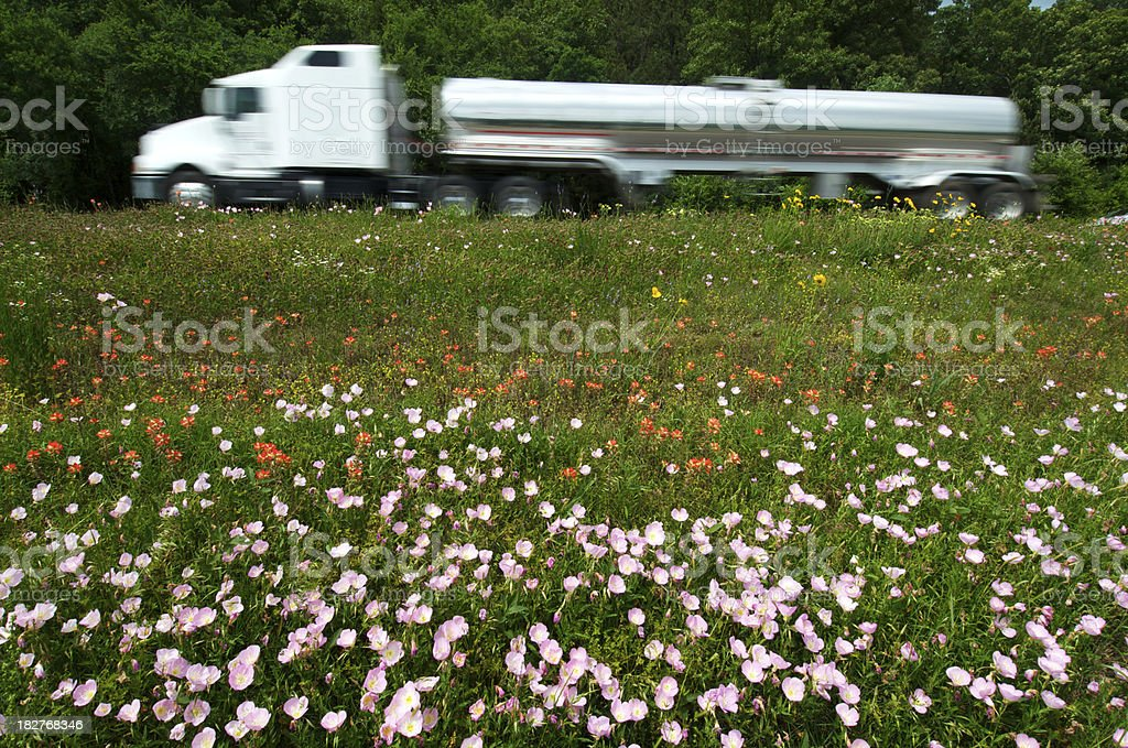 Fuel Truck and Wildflowers on the Interstate royalty-free stock photo