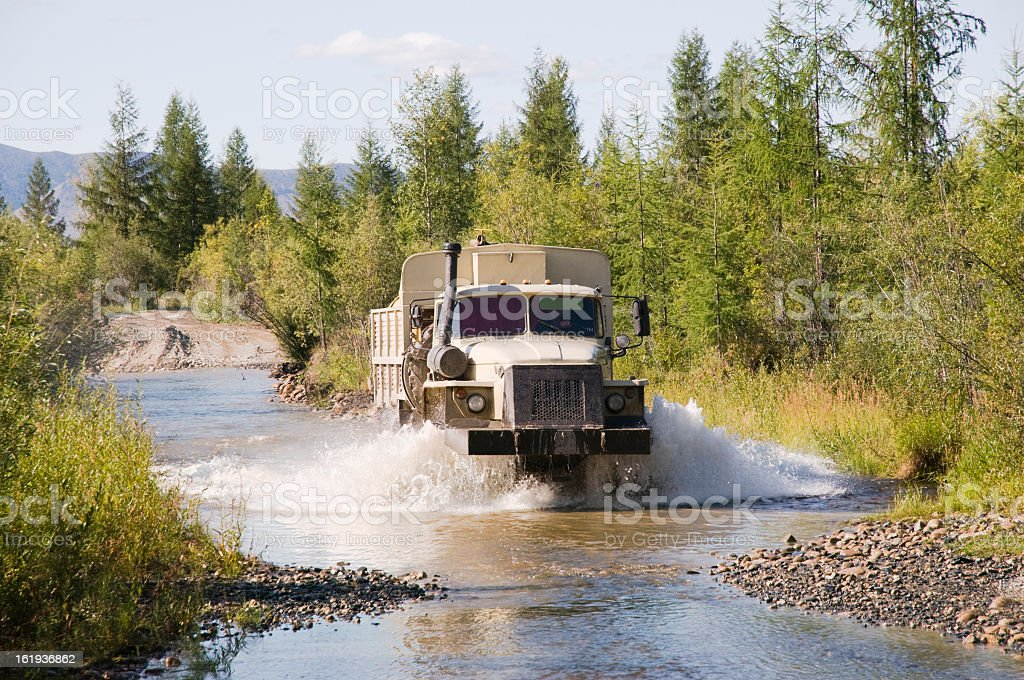 Fuel truck moves through a stream. Eastern Siberia. royalty-free stock photo