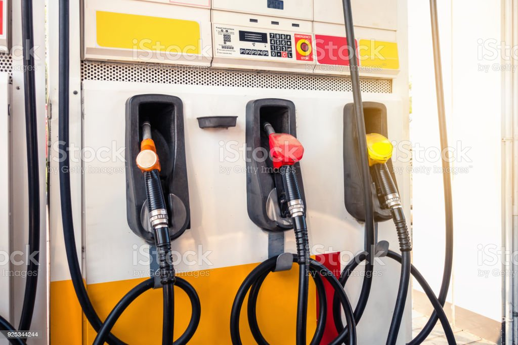 Fueling nozzles in gas station, Oil and gas station stock photo