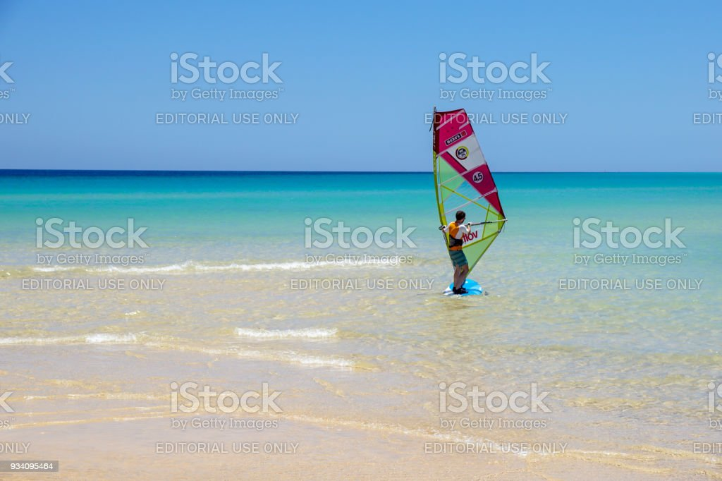 Fuerteventura , Canary island 08 June 2017 : A man is enjoying windsurfing. it is necessary to learn using a surf school. this sport is loved and practiced in all over the island - foto stock