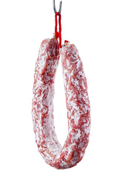 fuet.  secar salchichas con molde aislado - fuet sausages fotografías e imágenes de stock