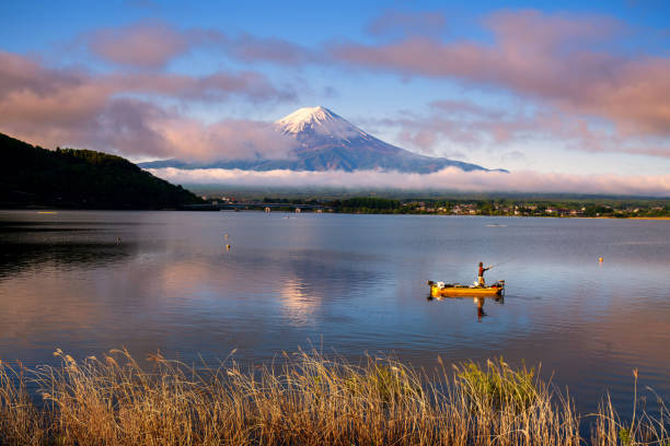 Fuji mountain and Kawaguchiko lake in morning, fog flow on the air and people do activity. Fuji mountain and Kawaguchiko lake in morning, fog flow on the air and people do activity. lake kawaguchi stock pictures, royalty-free photos & images