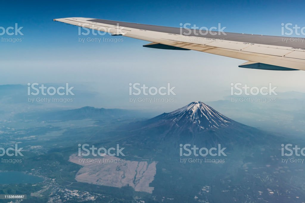 Fuji mountain and plane ving. Photo from the airplane Fuji mountain and plane ving. Photo from the airplane Above Stock Photo