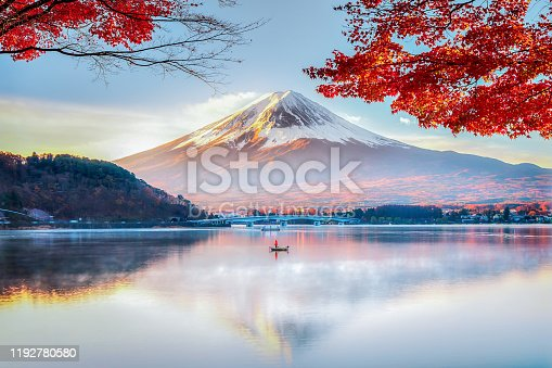 Fisherman Boat with Fuji Moutnain bacgkround in Morning Mist Autumn, Kawaguchikok Lake, Japan