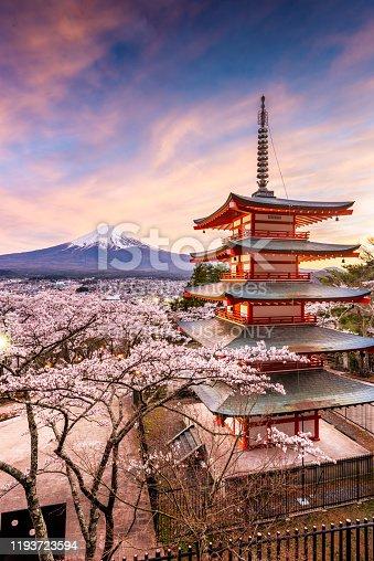 Fujiyoshida, Japan - April 18, 2017: Chureito Pagoda and Mt. Fuji in the spring with cherry blossoms at twilight.