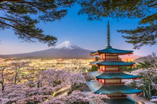 Fujiyoshida, Japan with Mt. Fuji and Chureito Pagoda stock photo