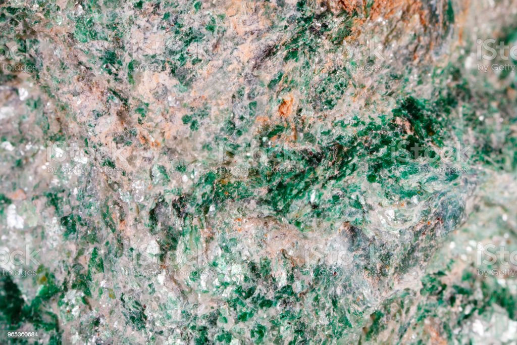 Fuksit. The texture of the mineral. Macro shooting of natural gemstone. The raw mineral. Abstract background royalty-free stock photo
