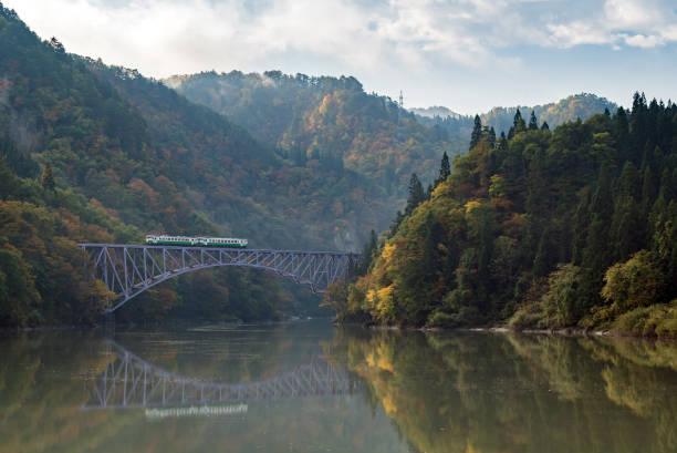 Fukushima First Bridge Tadami River Japan Autumn fall foliage Fukushima First Bridge View Point daiichi kyouryou in Mishima Fukushima Japan railway bridge stock pictures, royalty-free photos & images