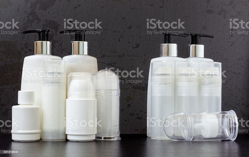 Full and Empty Beauty Product Bottles stock photo