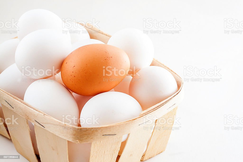 full basket of fresh eggs on a white background royalty-free stock photo