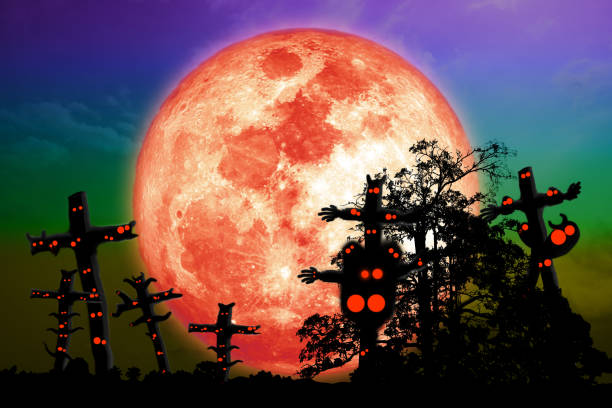 Full blood moon and silhouette tree on night sky with ghosts stock photo