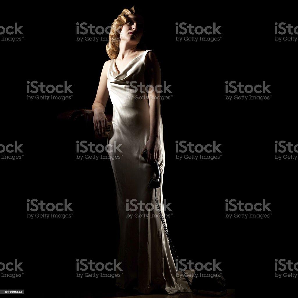 Full Body 1940's Woman Dangles Phone. Film-noir Retro Styling. stock photo