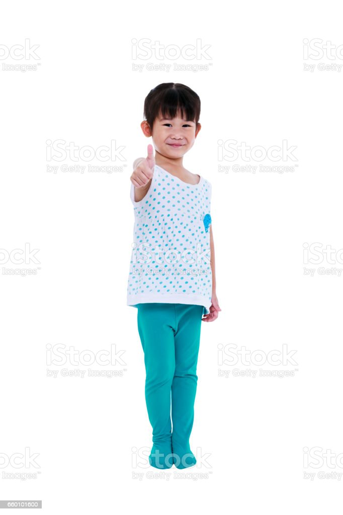 Full body. Asian girl smiling and showing thumbs up sign. stock photo