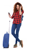 istock Full body female traveler with bags looking at cellphone 1035689372