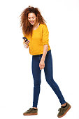 istock Full body happy woman looking at cellphone against isolated white background 1035693070