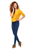 istock Full body happy woman talking with cellphone against isolated white background 1035693100