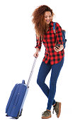 istock Full body happy woman with luggage looking at mobile phone 1035689364