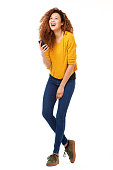 istock Full body happy woman with smart phone laughing against isolated white background 1035693114
