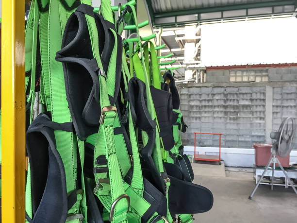 full body harness hanging on the rack,personal protective equipment for  height work full body harness ,hanging,rack,personal, protective, equipment,height ,work safety harness stock pictures, royalty-free photos & images