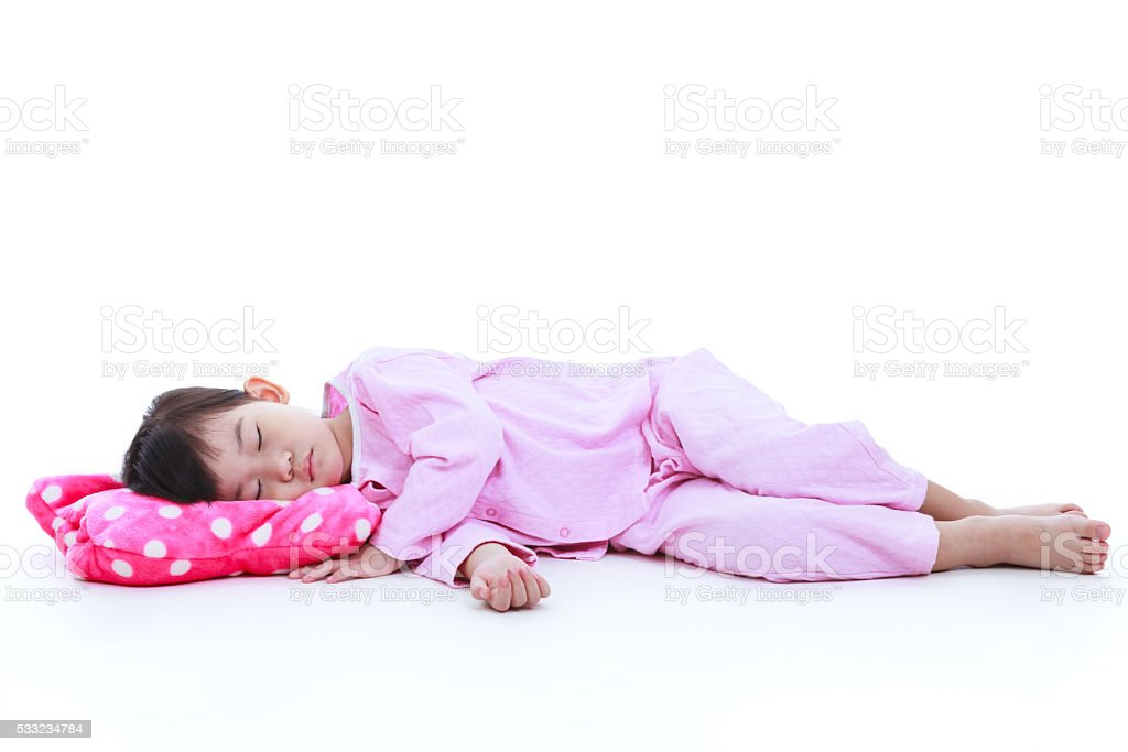 Full body. Healthy children concept. Asian girl sleeping peacefu stock photo