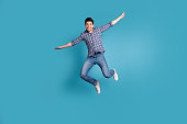 istock Full body length size photo of crazy humorous handsome carefree careless dreamy optimistic generation y millennial he him guy stretching arms hands to sides isolated pastel background 1157938216