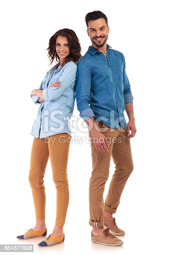 istock full body of a casual couple smiling 854377608