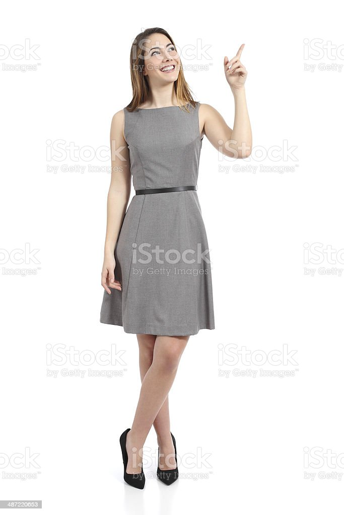 Full body of a standing woman pointing at side stock photo