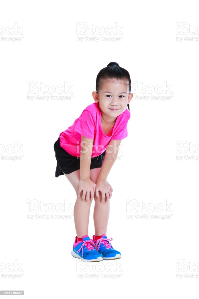 Full body of asian child smiling and standing with hands on her knees. Isolated on white. royalty-free stock photo