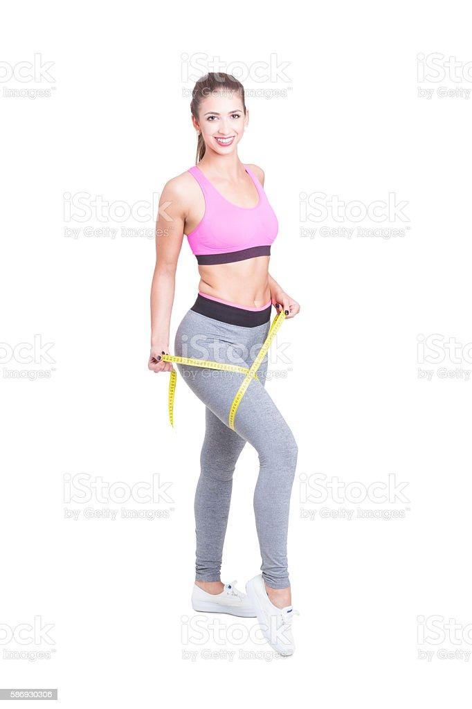 Full body of female measuring her leg stock photo