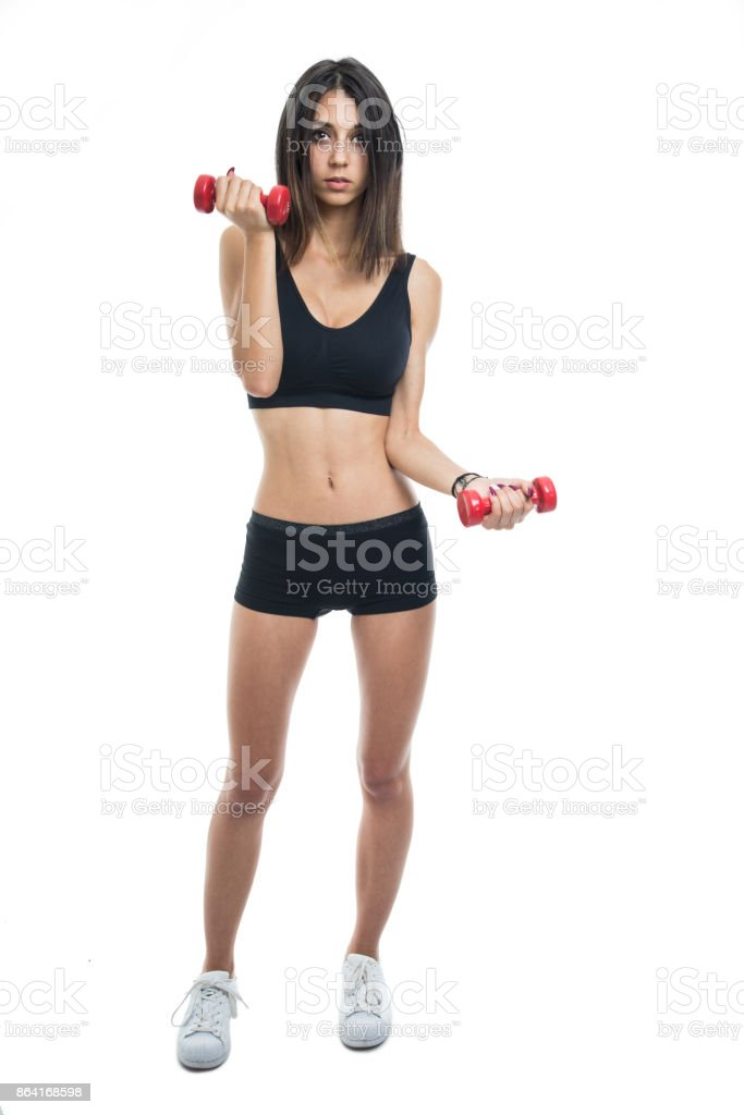 Full body of fit girl exercising with dumbbells royalty-free stock photo