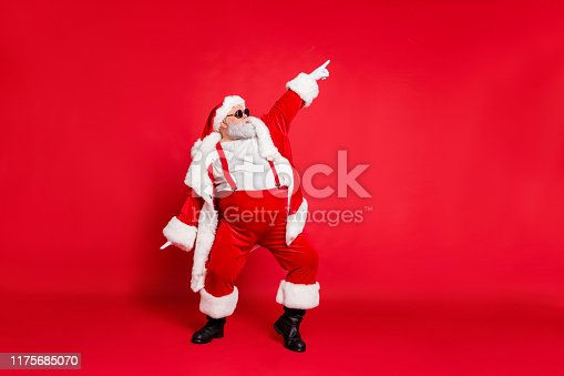 Full body photo of overweight carefree delightful ecstatic active energetic, listening hip-hop music chic grandfather pointing finger up enjoying rhythm movement has big belly isolated vivid background