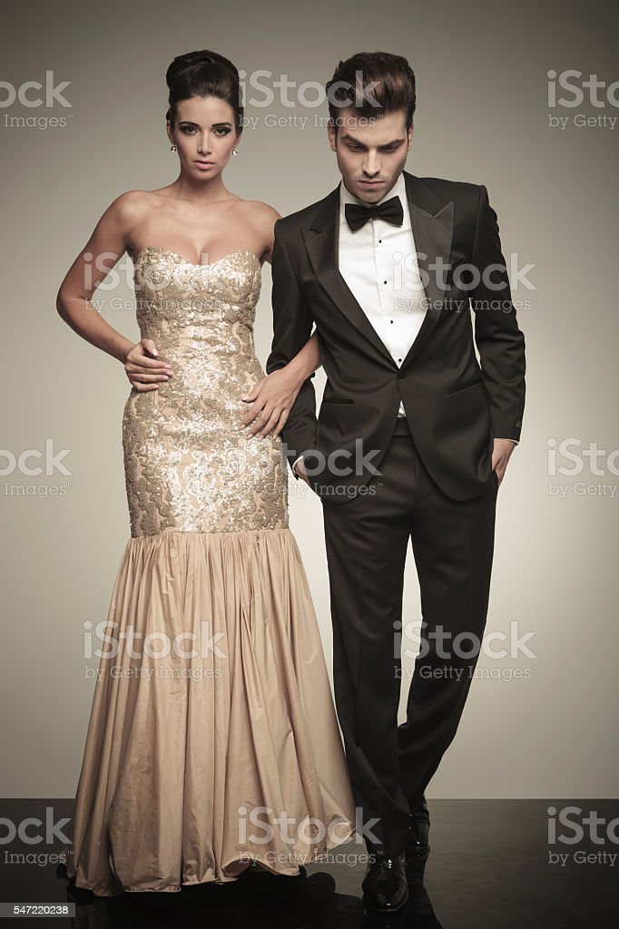 Full body picture of a elegant couple walking stock photo