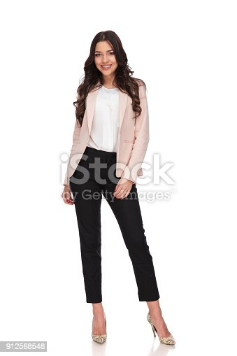 istock full body picture of a happy young business woman standing 912568548