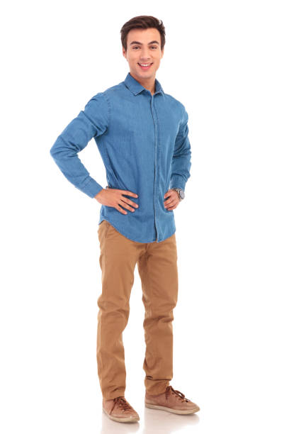 full body picture of a  man with hands on waist - one young man only stock photos and pictures