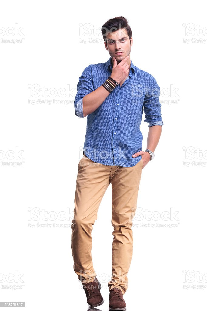 full body picture of a young casual man thinking stock photo