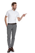 istock full body picture of  man pointing his finger to side 1131989194