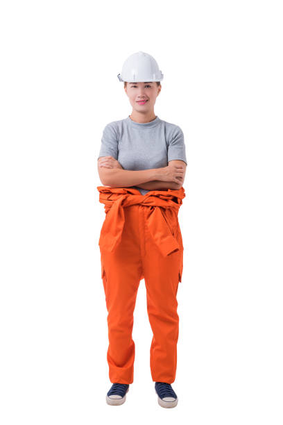 1547470b8d2 Full body portrait of a woman worker in Mechanic Jumpsuit isolated on white  background stock photo